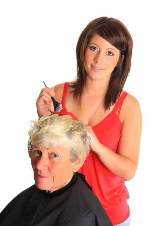 tinte cabello: Pareja peluquero destaca la puesta en clientes cabello.