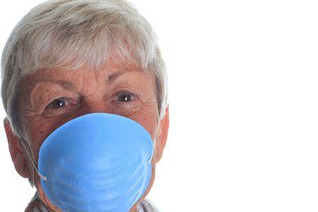 swine flue: Senior lady wearing a flu mask.