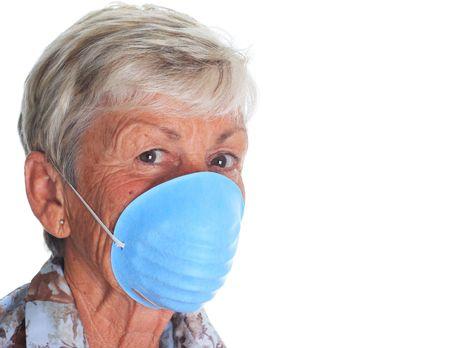 swine flue: Senior lady wearing a flu mask.  Stock Photo