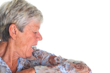 Elderly woman sneezing into her sleeve. Stop the spread of germs! Stock Photo