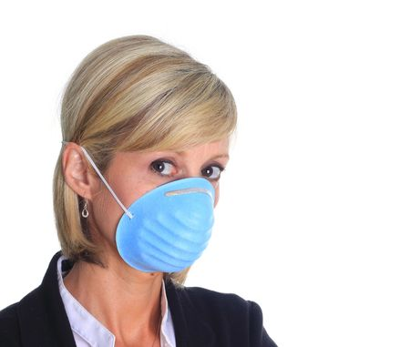 swine flue: Woman with a mask as protection again the influenza virus.