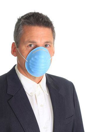 swine flue: Man wearing a mask as protection against the influenza virus.