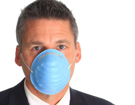 Man wearing a mask as protection against the influenza virus.  Stock Photo - 5332832