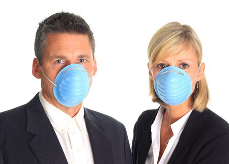 swine flue: Man and woman wearing flu masks. Stock Photo