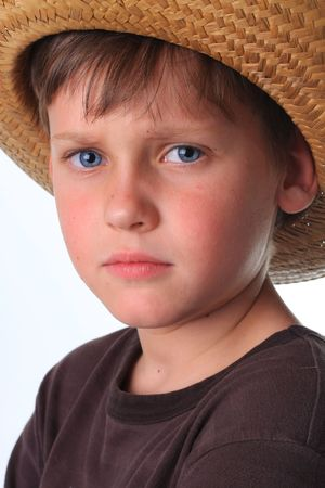 Cute freckle faced boy wearing a cowboy hat.  Stock Photo - 5568042