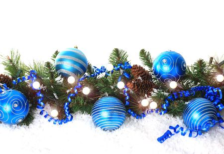 blue green background: Christmas border with lights, blue ornaments and snow.
