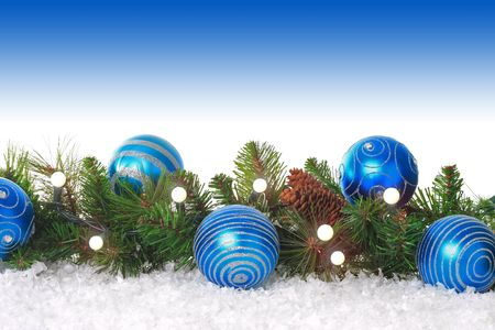 christmas decorations with white background: Christmas border with lights, blue ornaments and snow.