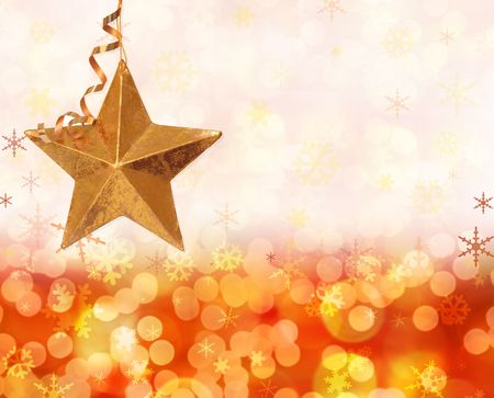 boke: Sparkling festive background of golden Christmas lights and snowflakes with gold star.  Stock Photo