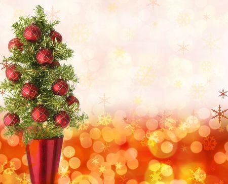 festive: Pretty Christmas tree on a festive background.  Stock Photo