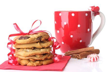Christmas cookies with a mug of cinnamon hot chocolate.  photo