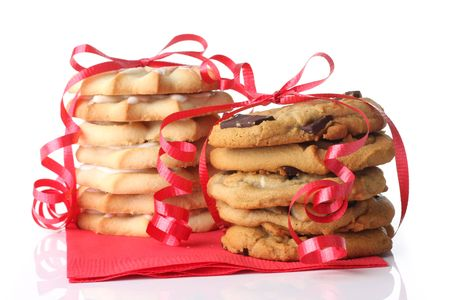 Christmas cookies, shortbread and chocolate, wrapped in red ribbon.  photo