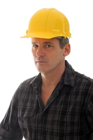hard: Construction worker in a yellow hard hat.  Stock Photo