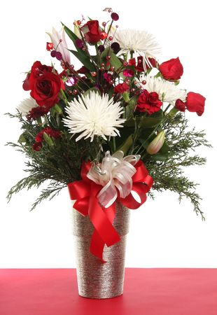 flower arrangements: Festive and floral arrangement with roses and chrysanthemums.