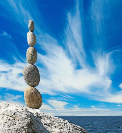 Stack of stones by the ocean.  photo
