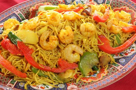 Chinese food of curry prawns, vegetables and noodles.  photo