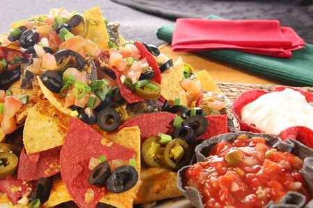 Nachos with cheese, salsa and sour cream.