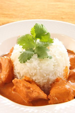 Indian butter chicken over rice.  photo
