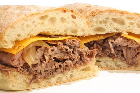 Beef dip sandwich with cheese and au jus.  Stock Photo - 6517867