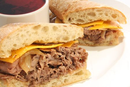 jus: Roast Beef dip sandwich with cheese.