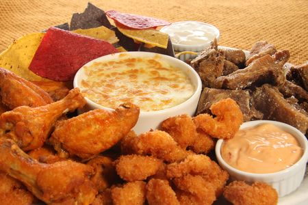 Appetizer platter of chicken wings, ribs, shrimp and nachos. Stock Photo - 6517874