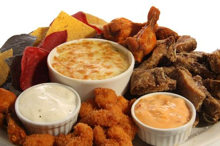 Appetizer platter of chicken wings, ribs, shrimp and nachos.  Stock Photo - 6517869