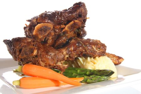 rib: Beef ribs with mashed potatoes, carrots and asparagus.  Stock Photo