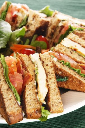 Clubhouse sandwich with grilled chicken and bacon. Also available in horizontal.  photo