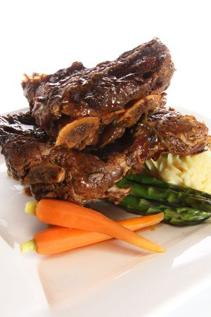 entrees: Beef ribs with mashed potatoes, carrots and asparagus. Also available in horizontal.