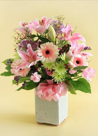 centerpiece: Flower arrangement in pink. Stock Photo