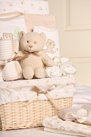 Baby gift basket including bear, sleeper, blankets and booties. Also available in horizontal.