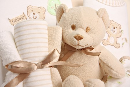 Baby gift basket including a teddy bear, blankets and sleepers. Also available in vertical.