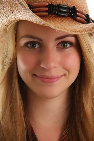 Beautiful blond girl wearing a cowboy hat.  photo