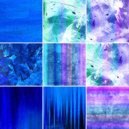 Collection of abstract painted canvas art in shade of blue.  photo