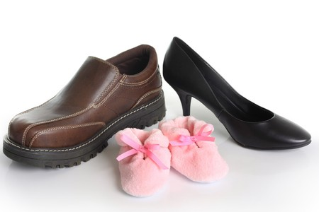 Parents shoes with pink booties. Also available with blue booties. Birth announcement concept.  photo