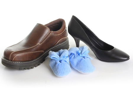 Parents shoes with blue booties. Also available with pink booties. Birth announcement concept.  photo