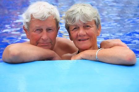 Senior couple in the swimming pool  photo