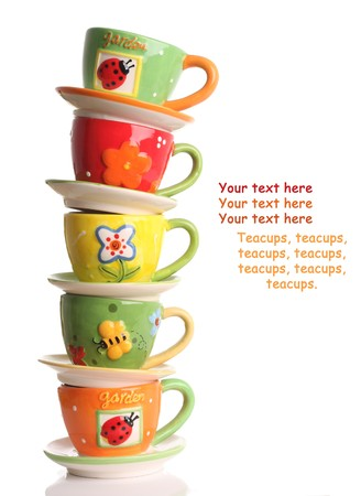 crockery: Stack of colorful teacups.