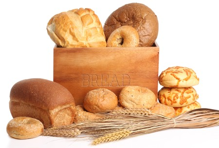 Bread box surrounded by bread and buns. Also available in vertical. Stock Photo - 7621180