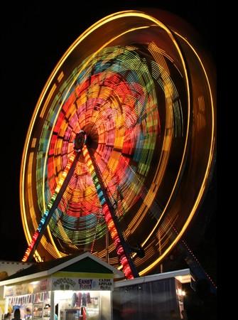 Ferris wheel spinning at night.  photo