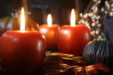 Apple shaped candles surrounded by autumn decorations. Stock Photo - 8017279