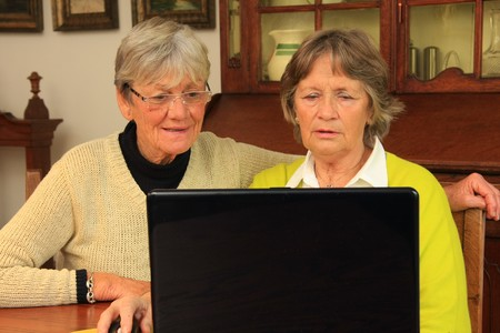 Seventy year old ladies surfing the net.  photo