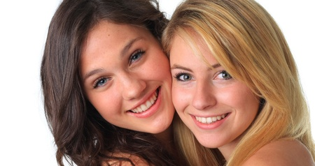 best: Cute teenage girls, best friends, smiling and hugging.  Stock Photo