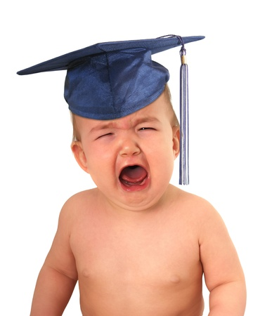 Crying baby wearing grad cap. High cost of education concept.
