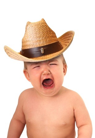 Crying baby wearing a cowboy hat.  photo