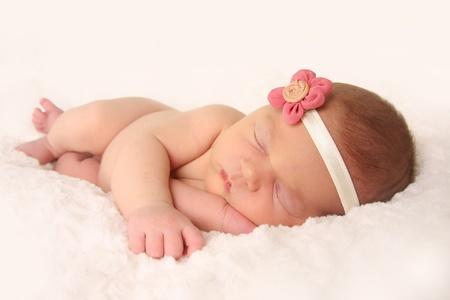 headband: Newborn baby girl, sleeping.