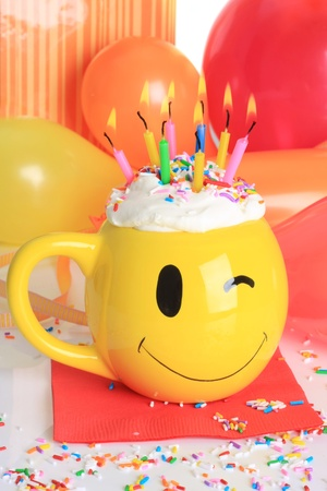 Happy birthday cupcake with candles and balloons. Stock Photo - 8967067
