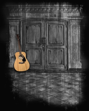 Acoustic guitar against a dark grunge hallway background