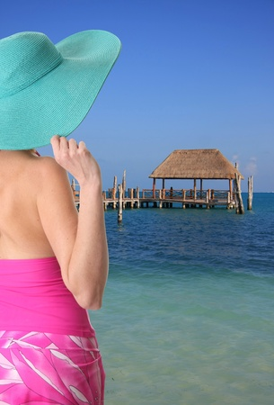 Lady wearing a sun hat on a Caribbean beach photo
