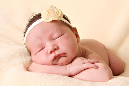 Newborn baby girl sleeping. Stock Photo