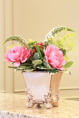 Classic floral arrangement in an elegant vase.  photo